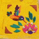 Antigua - part of a carpet showing a kolibri and a flower