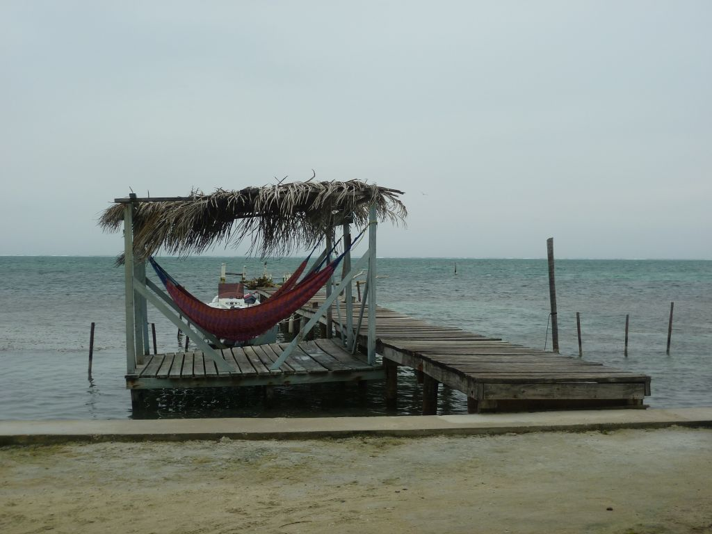 Caye Caulker 5: dock of Yumas House with hammocks