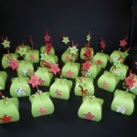 Small green bags with red Christmassy decorations for a good friend who is just going through a hard time.