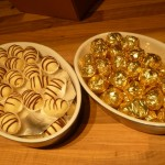 Egg-liqueur pralines and vanilla truffles ready to be wrapped