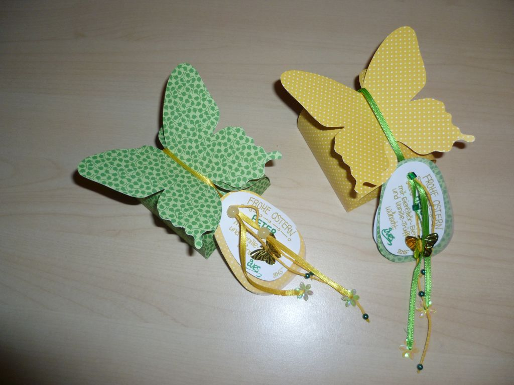 Green and yellow butterfly models with ribbons and a personal note