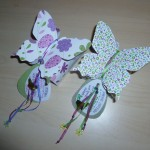 White and purple butterfly models with ribbons and a personal note